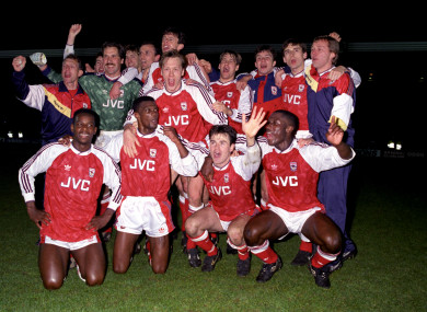 Arsenal celebrate winning the League Championship in 1991: (back row, l-r) coach Stewart Houston, Nigel Winterburn, David Seaman, Tony Adams, Steve Bould, David O'Leary, Paul Merson, David Hillier, Alan Smith, physio Gary Lewin; (front row, l-r) Michael Thomas, Paul Davis, Lee Dixon, Anders Limpar, Kevin Campbell.