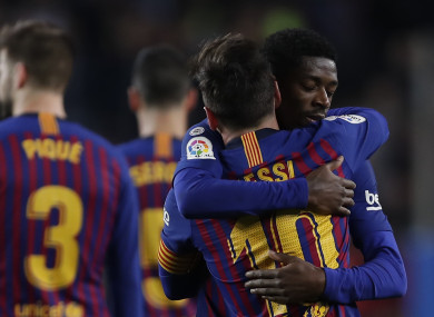Lionel Messi celebrates with Ousmane Dembélé.