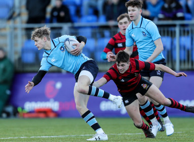 Darragh O'Reilly tackles Andrew Smith of St MIchael's.