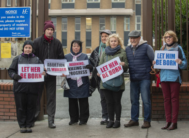 People stage a protest against abortion at the gates of Our Lady of Lourdes Hospital today.
