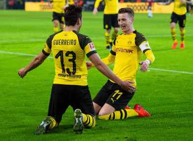 Raphael Guerreiro and Marco Reus celebrating a goal for Borussia Dortmund.