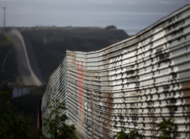 A border wall makes its way towards the ocean in Tijuana, Mexico