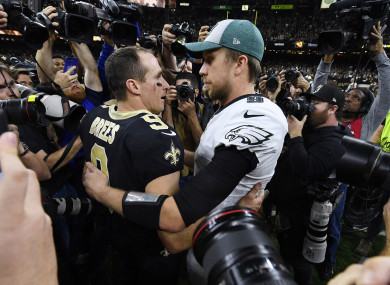 Drew Brees and Nick Foles embrace after the playoff game last night.