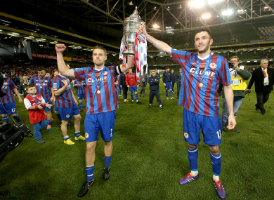 Brennan lifting the FAI Cup with Pat's captain Ger O'Brien in 2014.