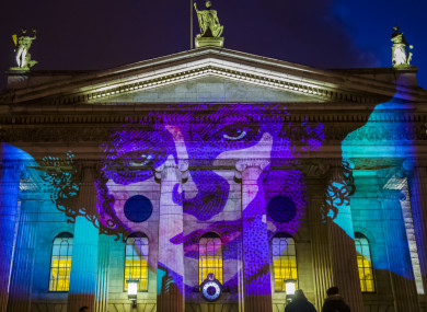 Suffragette and trade unionist Countess Markievicz, art by Jim Fitzpatrick, illuminating the GPO