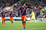 Man City ease past Huddersfied to close the gap on Liverpool