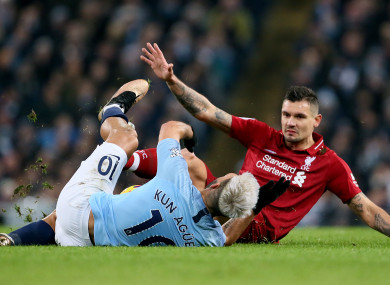 Dejan Lovren picks up a yellow card for this tackle on Sergio Aguero on Thursday night.