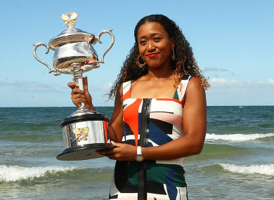 Australian Open champion Naomi Osaka poses with the women's trophy in Melbourne.