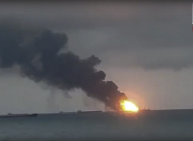 In this video grab provided by the Kerch.fm web portal, the two vessels, the Maestro and the Candiy, on fire near the Kerch Strait linking the Black Sea and the Sea of Azov, in Kerch, Crimea.