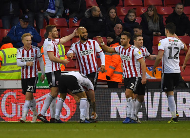 Sheffield United's David McGoldrick is congratulated on scoring his team's opening goal.
