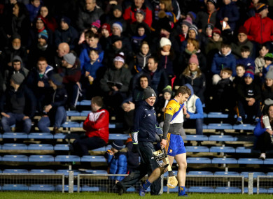 Tony Kelly leaves the pitch after being sent-off.