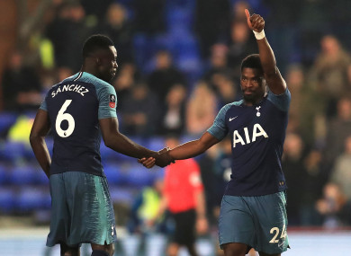Serge Aurier celebrates Spurs' third with Davinson Sanchez.