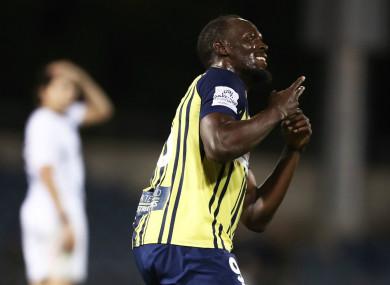 Usain Bolt celebrates scoring for the Mariners.