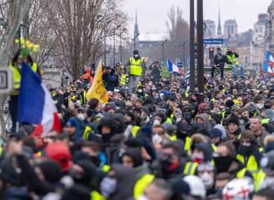 Protesters take part in a demonstration by the 'yellow vests' movement in Paris