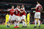 Arsenal recover first-leg deficit to ease past BATE Borisov