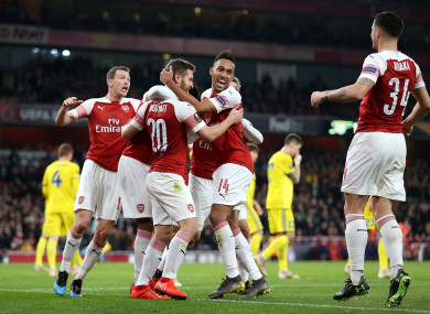 Shkodran Mustafi (centre) is mobbed by teammates after scoring.
