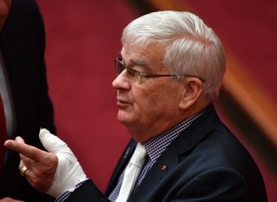 United Australia Party Senator Brian Burston with a bandaged hand in the Senate chamber in Canberra
