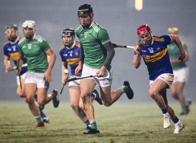 Conor Boylan races clear of the Tipp defence.