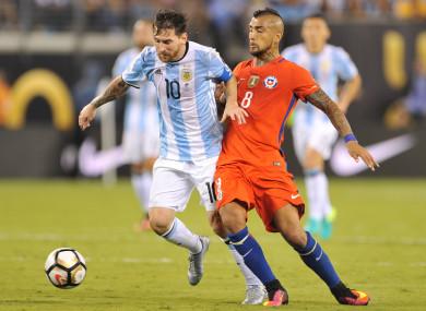 Argentina's Lionel Messi and his Barcelona team-mate, Arturo Vidal of Chile.