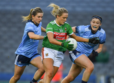 Fiona Doherty of Mayo races past Martha Byrne, left, and Olwen Carey of Dublin on her way to scoring her side's third goal.