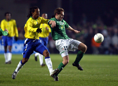 Ronaldinho and Jason McAteer compete for possession in February 2004.