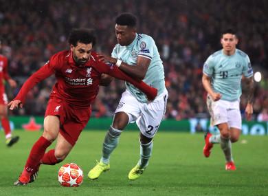 Mohamed Salah David Alaba battle for the ball.