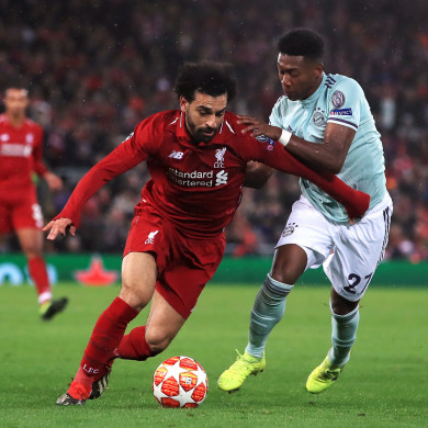 Mohamed Salah David Alaba battle for the ball.