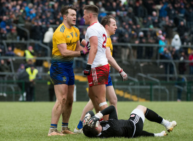 Tyrone's Michael McKernan has words with Roscommon's Ultan Harney after a clash with Niall Morgan.