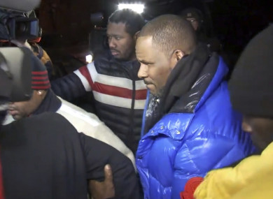 R Kelly arriving at a Chicago police precinct last night