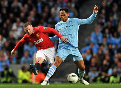 Lescott and Rooney battling for possession in 2012.