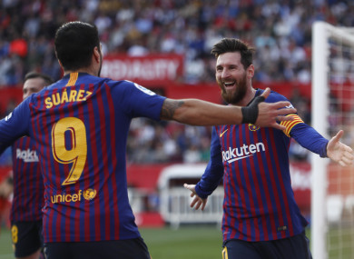 Lionel Messi celebrates completing his hat-trick with Luis Suarez.