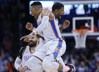 Perfect 10: Westbrook, left, and Paul George celebrate.