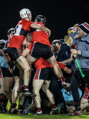 UCC celebrate at the final whistle.