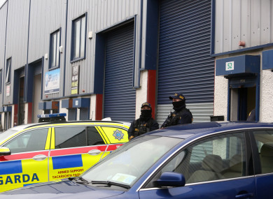 Armed gardai at the scene in Greenogue business park where firearms and ammunition were seized.