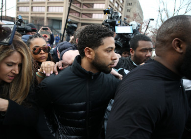 Empire actor Jussie Smollett (centre) has been indicted by a grand jury in Chicago.