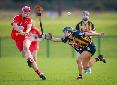 Chloe Sigerson gets the ball away with Anna Farrell in close attention.