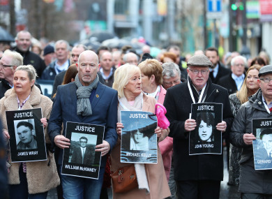 Families of those who died march through the Bogside in Derry today ahead of the announcement.