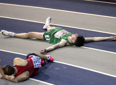 Ireland's Cillin Greene lies on the track after the collision.