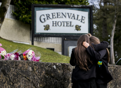Students from Holy Trinity College leave floral tributes outside The Greenvale Hotel in Cookstown