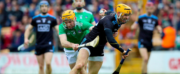 Limerick's Richie English tangling with Eamonn Dillon of Dublin.