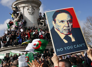 Demonstrators in Paris stage a protest to denounce President Abdelaziz Bouteflika's bid for a fifth term