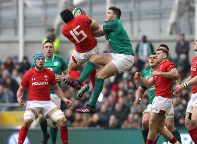 Jacob Stockdale and Leigh Halfpenny compete for a ball during last year's Six Nations.