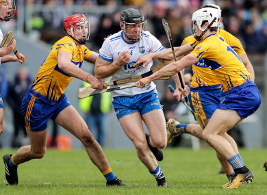 Waterford's Kevin Moran with Peter Duggan and Aidan McCarthy of Clare.