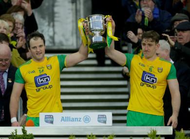 Michael Murphy and Hugh McFadden lift the Division 2 trophy.