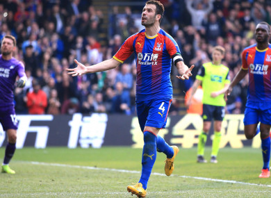 Luka Milivojevic celebrates scoring from the spot against Huddersfield Town.