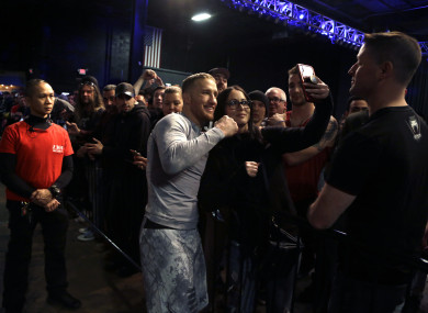 MMA star Justin Gaethje poses with fans after a pre-fight workout in Philly.