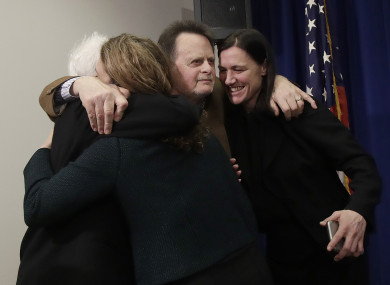 Edwin Hardeman (centre) and his wife Mary (left) hug their lawyers after the verdict was announced.