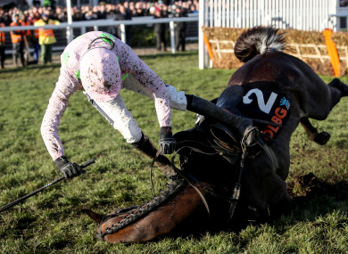 Rugby Walsh falls off Benie Des Dieux during the fifth race of the day.