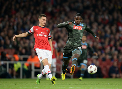 Arsenal defender Laurent Koscielny and Napoli's Duvan Zapata when they met in the 2013 Champions League.