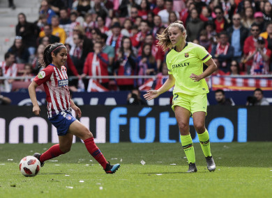 Atletico's Vaitiare Kenti Robles and Barcelona's Lieke Martens compete for possession.